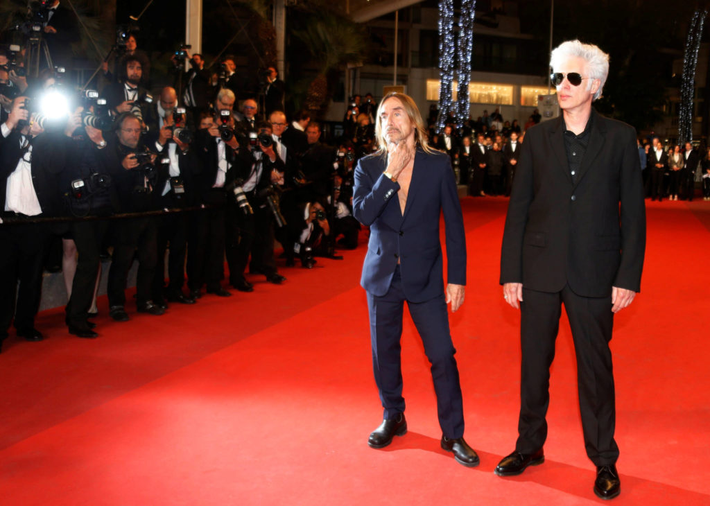 "Director Jim Jarmusch and singer Iggy Pop pose on the red carpet as they arrive for the screening of the film ""Gimme Danger"" out of competition at the 69th Cannes Film Festival in Cannes, France, May 20, 2016. REUTERS/Regis Duvignau - RTSF2QL"
